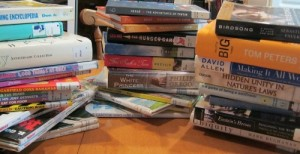 Reading week's first 30 library books.  A few went immediately into the return pile--you can probably pick them out.